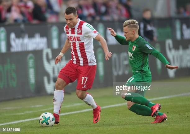 Christian Clemens of Koeln and Philipp Max of Augsburg battle for the ball during the Bundesliga match between 1 FC Koeln and FC Augsburg at...