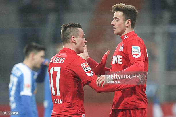 Christian Clemens of Koeln celebrates after scoring a goal to make it 01 with Lukas Kluenter of Koeln during a friendly match between VfL Bochum and...