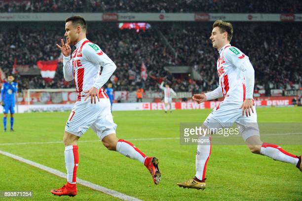 Christian Clemens of Koeln celebrates after scoring his team`s first goal with Lukas Kluenter of Koeln during the Bundesliga match between 1 FC Koeln...