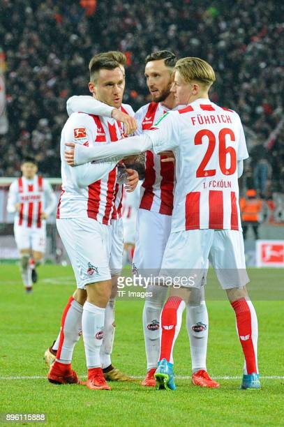 Christian Clemens of Koeln celebrates after scoring his team`s first goal with team mates during the Bundesliga match between 1 FC Koeln and VfL...