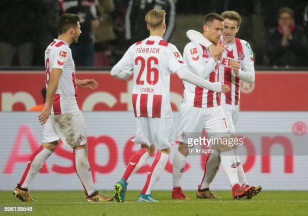 Christian Clemens of Koeln celebrates after scoring his team`s first goal during the Bundesliga match between 1 FC Koeln and VfL Wolfsburg at...