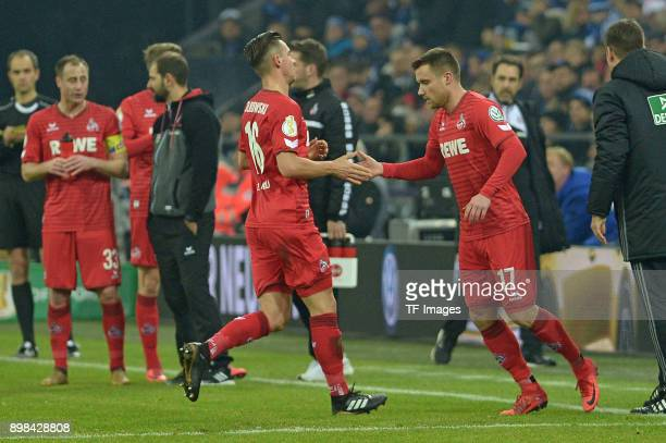 Christian Clemens of Koeln comes on as a substitute for Pawel Olkowski of Koeln during the Bundesliga match between FC Schalke 04 and 1 FC Koeln at...