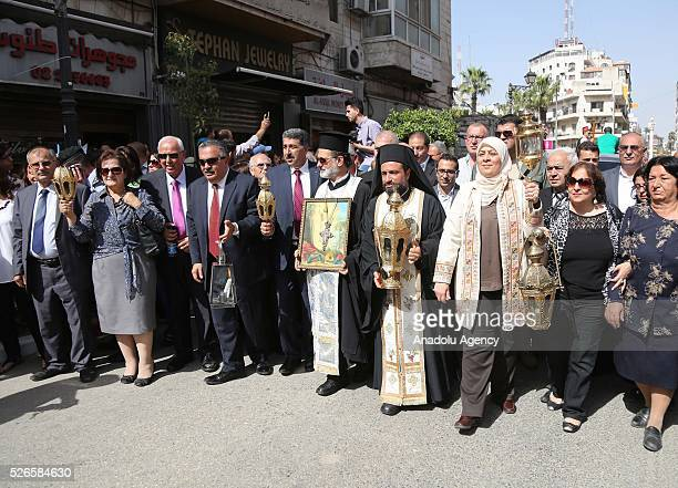 """Christian clergymen attend the """"Holy Fire"""" parade on Holy Saturday ahead the Easter at the streets of Ramallah in West Bank on April 30, 2016. Holy..."""