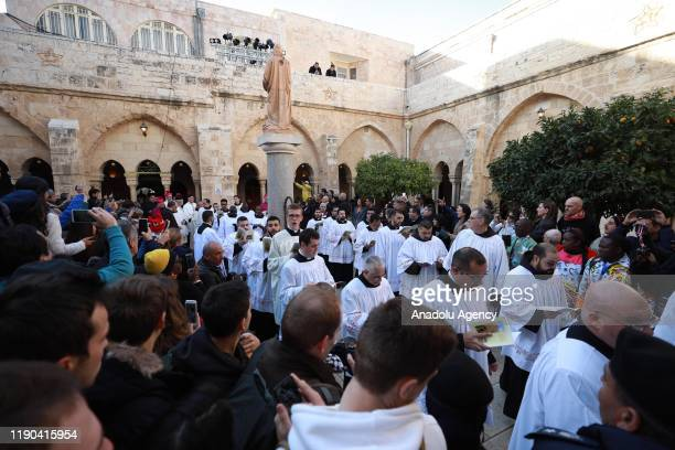 Christian clerics arrive the Church of St Catherine to lead the ritual to mark Christmas in Bethlehem West Bank on December 24 2019