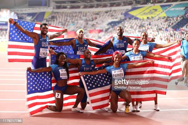 Christian Coleman Justin Gatlin Michael Rodgers and Noah Lyles of the United States celebrate gold in the Men's 4x100 Relay with Dezerea Bryant...