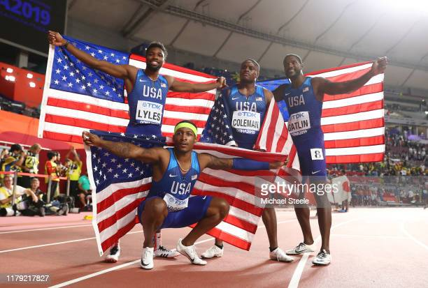 Christian Coleman, Justin Gatlin, Michael Rodgers and Noah Lyles of the United States celebrate gold in the Men's 4x100 Metres Relay during day nine...