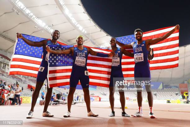 Christian Coleman Justin Gatlin Michael Rodgers and Noah Lyles of the United States celebrate gold in the Men's 4x100 Metres Relay during day nine of...