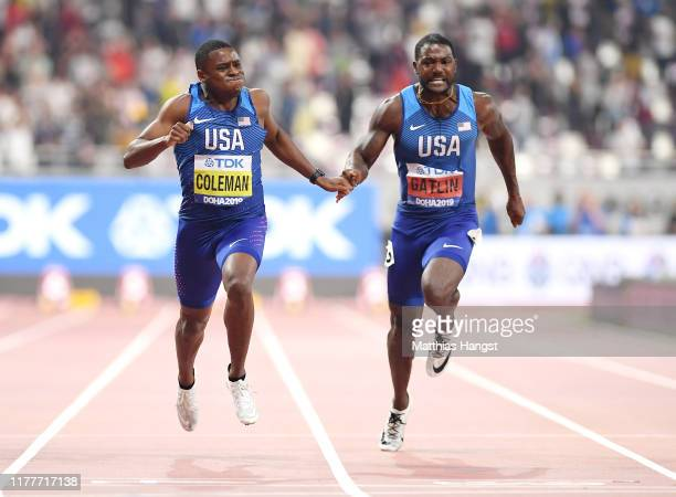 Christian Coleman of the United States crosses the finish line next to Justin Gatlin of the United States to win the Men's 100 Metres final final...