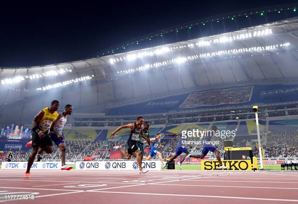 Christian Coleman of the United States, gold, Justin Gatlin of the United States, silver and Andre De Grasse of Canada, bronze, cross the finish line...