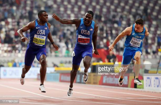 Christian Coleman of the United States, gold, Justin Gatlin of the United States, silver and Filippo Tortu of Italy cross the finish line in the...