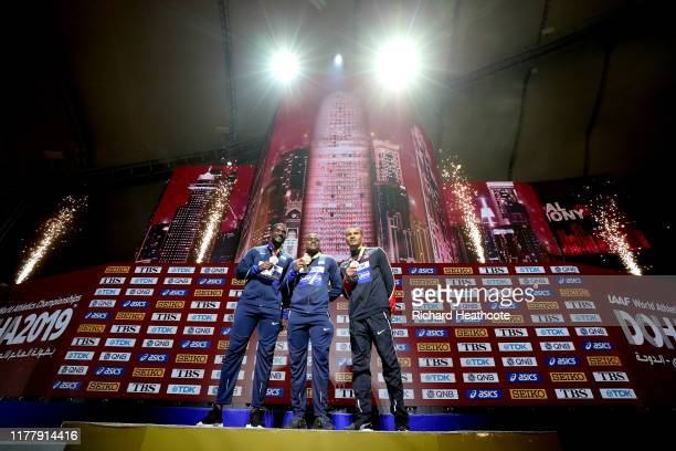Christian Coleman of the United States, gold, Justin Gatlin of the United States, silver, and Andre De Grasse of Canada, bronze, pose during the...
