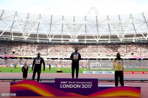 Christian Coleman of the United States silver Justin Gatlin of the United States gold and Usain Bolt of Jamaica broze pose with their medals for the...