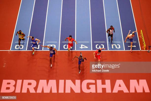 Christian Coleman of United States dips to beat Bingtian Su of China in the 60 Meters Mens Final during the IAAF World Indoor Championships on Day...
