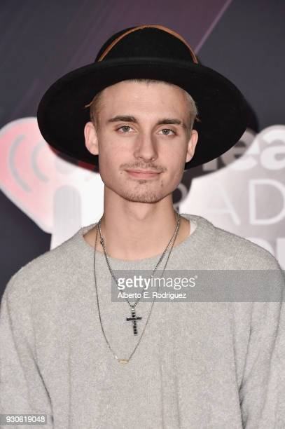 Christian Collins arrives at the 2018 iHeartRadio Music Awards which broadcasted live on TBS TNT and truTV at The Forum on March 11 2018 in Inglewood...
