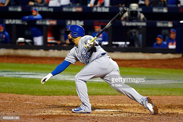 Christian Colon of the Kansas City Royals hits a single to score Jarrod Dyson in the twelfth inning against Addison Reed of the New York Mets during...
