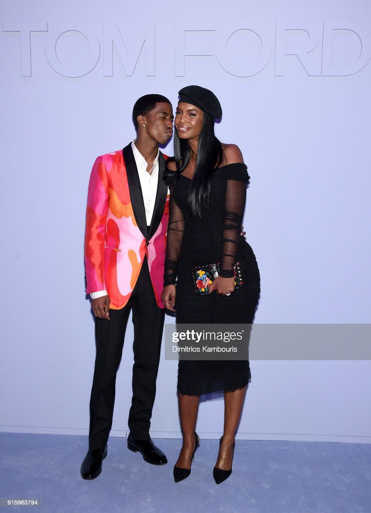 Christian Combs and Kim Porter attend the Tom Ford Fall/Winter 2018 Women's Runway Show at the Park Avenue Armory on February 8, 2018 in New York City.