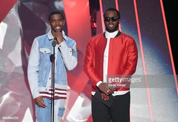 Christian Combs and Sean 'Diddy' Combs speak onstage during the 2018 iHeartRadio Music Awards which broadcasted live on TBS TNT and truTV at The...