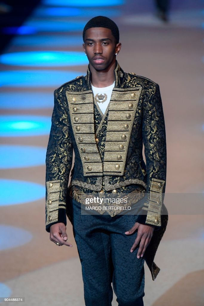 Christian Combs, the son of P Diddy, presents a creation for fashion house Dolce & Gabbana during the Men's Fall/Winter 2019 fashion shows in Milan, on January 13, 2018. / AFP PHOTO / Marco BERTORELLO