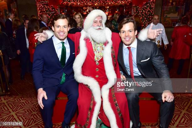 Christian Conway Santa Claus and Jackson Conway attend George Farias Anne Jay McInerney Host A Holiday Party at The Doubles Club on December 13 2018...