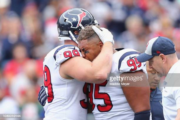 Christian Covington of the Houston Texans hugs JJ Watt after suffering an apparent injury on during the first half against the New England Patriots...