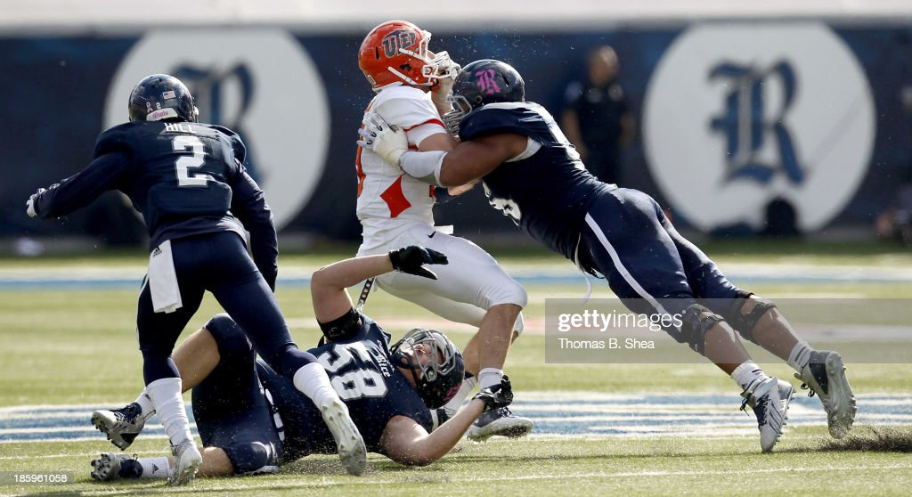 Christian Covington #56 of the Rice Owls tackled Blaire Sullivan #10 of the UTEP Miners on October 26, 2013 at Rice Stadium in Houston, Texas.