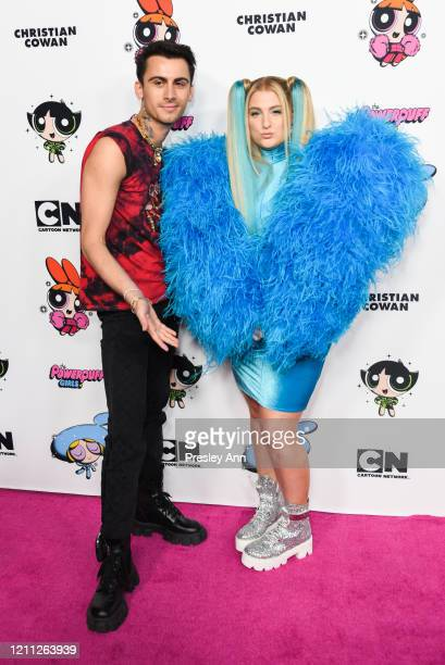 Christian Cowan and Meghan Trainor attend Christian Cowan x Powerpuff Girls Runway Show on March 08 2020 in Hollywood California