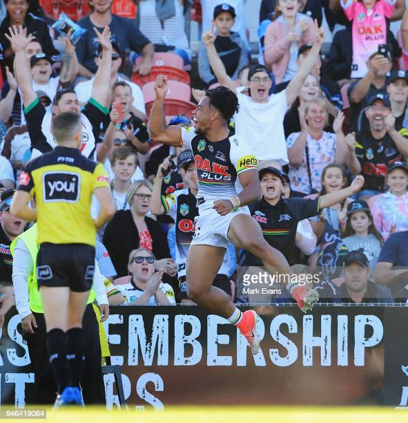 Christian Crichton of the Panthers celebrates a try during the round six NRL match between the Penrith Panthers and the Gold Coast Titans on April 15...