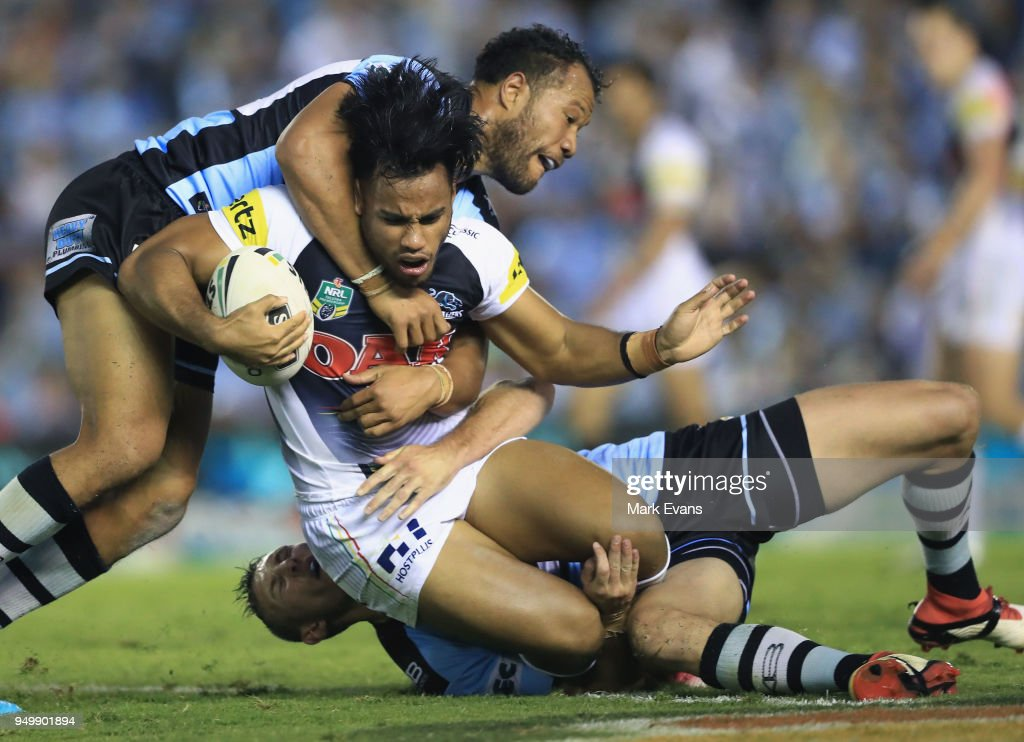 Christian Crichton of the Panthers is tackled during the round seven NRL match between the Cronulla Sharks and the Penrith Panthers at Southern Cross Group Stadium on April 22, 2018 in Sydney, Australia.