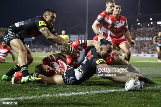 Christian Crichton of the Panthers scores a try during the round 12 NRL match between the Penrith Panthers and the St George Illawarra Dragons at...