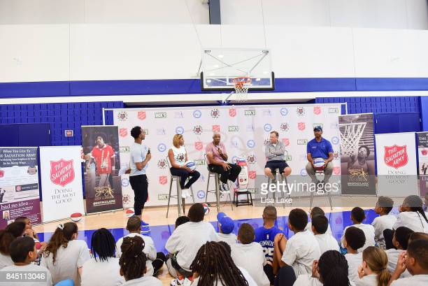 Christian Crosby Jazmin and Julius Erving Tom Shirley and Charles Turner speak to children during the Erving Youth Basketball Clinic on September 9...