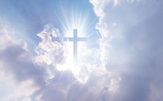 Christian cross appears bright in the sky 879917312