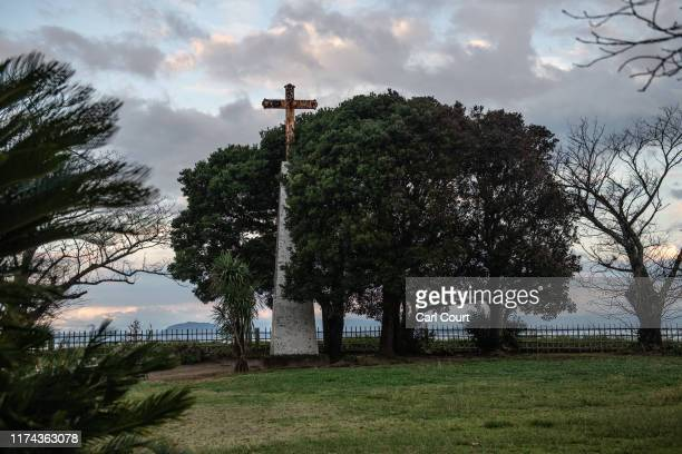 Christian cross stands in the ruins of Hara Castle which was the final battleground of an uprising of Christian peasants against excessive taxation...