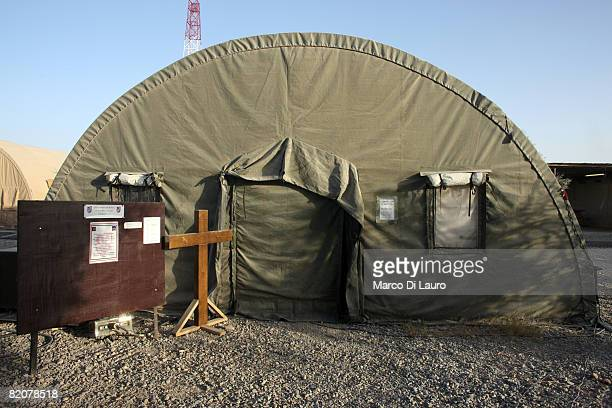 Christian cross stands outside the tent functioning as Chapel of St Martin at the British army base Task Force Helmand Headquarter on July 23 2008 in...