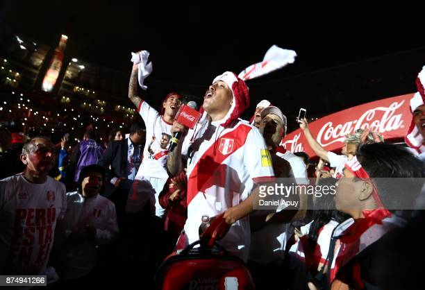 Christian Cueva and Sergio Pena of Peru celebrate the qualification after the second leg match between Peru and New Zealand as part of the 2018 FIFA...
