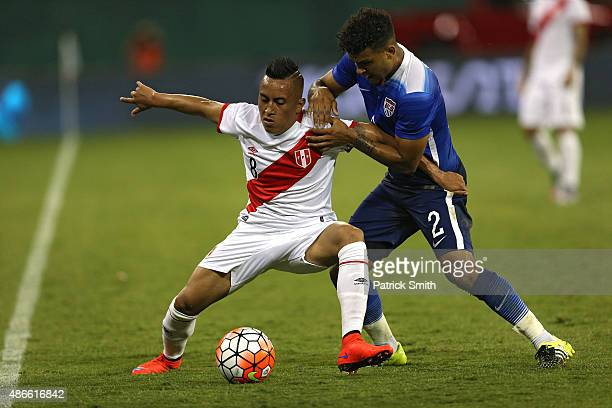 Christian Cueva of Peru and DeAndre Yedlin of the United States battle for the ball in the second half during an international friendly at RFK...