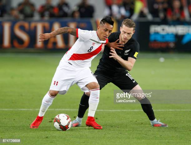 Christian Cueva of Peru and Jeremy Brockie of New Zealand fight for the ball during the second leg match between Peru and New Zealand as part of the...