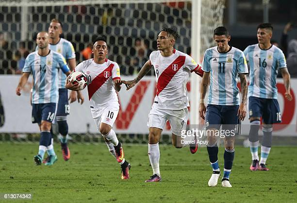 Christian Cueva of Peru celebrates with teammate Paolo Guerrero after scoring his team's second goal during a match between Peru and Argentina as...