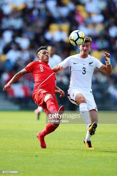 Christian Cueva of Peru competes with Deklan Wynne of the All Whites during the 2018 FIFA World Cup Qualifier match between the New Zealand All...