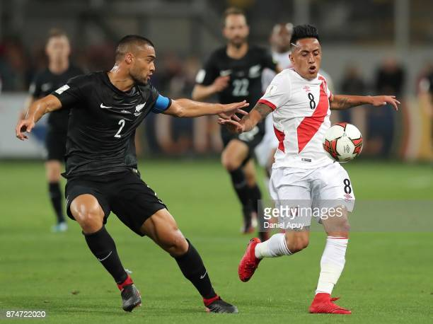 Christian Cueva of Peru fights for the ball with Winston Reid of New Zealand during a second leg match between Peru and New Zealand as part of the...