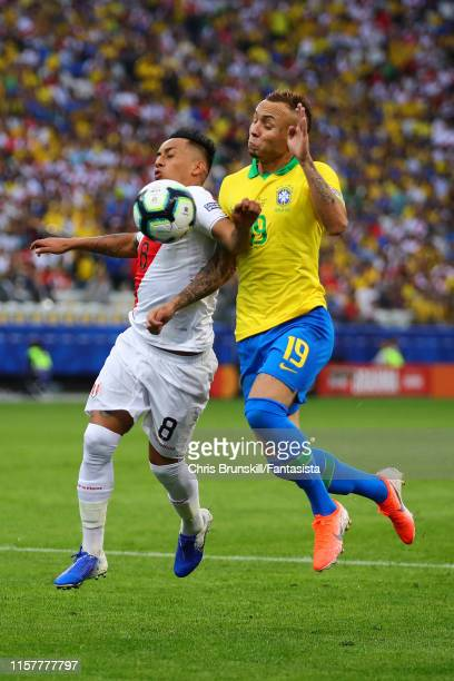 Christian Cueva of Peru in action with Everton of Brazil during the Copa America Brazil 2019 group A match between Peru and Brazil at Arena...