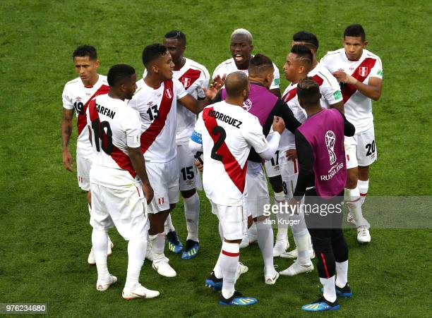Christian Cueva of Peru is consoled by team mates after missinga penalty during the 2018 FIFA World Cup Russia group C match between Peru and Denmark...