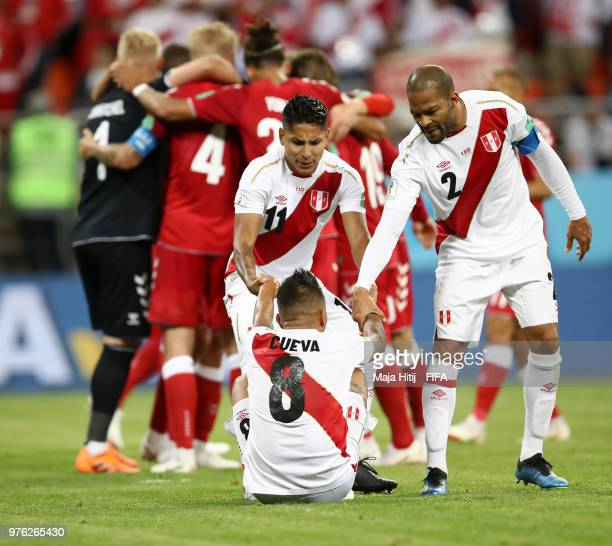 Christian Cueva of Peru is consoled by team mates Raul Ruidiaz and Alberto Rodriguez during the 2018 FIFA World Cup Russia group C match between Peru...