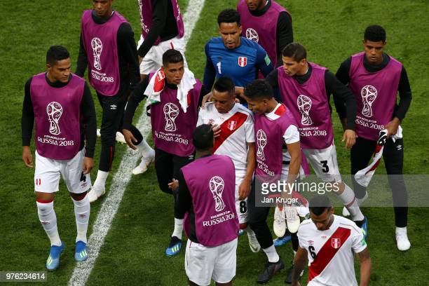 Christian Cueva of Peru is consoled by teammates as he walks off at half time, moments after missing a penalty during the 2018 FIFA World Cup Russia...