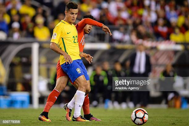 Christian Cueva of Peru struggle for the ball against Philippe Couthino of Brazil during the 2016 Copa America Centenario Group B match between...