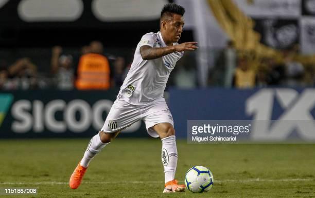 Christian Cueva of Santos controls the ball during a match between Santos and Internacional for the Brasileirao Series A 2019 at Vila Belmiro Stadium...
