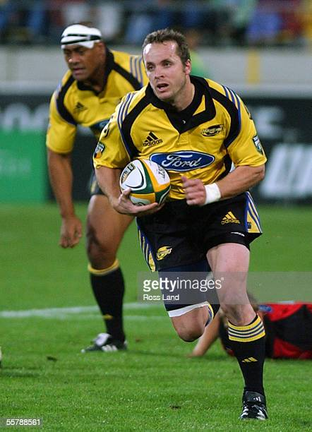 Christian Cullen makes a run upfield supported by Jonah Lomu , during the Super12 rugby match between the Hurricanes and Crusaders WestpacTrust Park,...