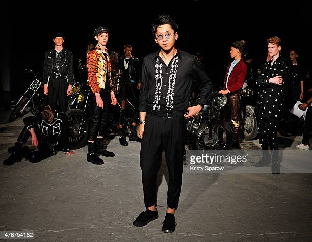 Christian Dada poses with models during the Christian Dada Menswear Spring/Summer 2016 Presentation as part of Paris Fashion Week on June 27 2015 in...