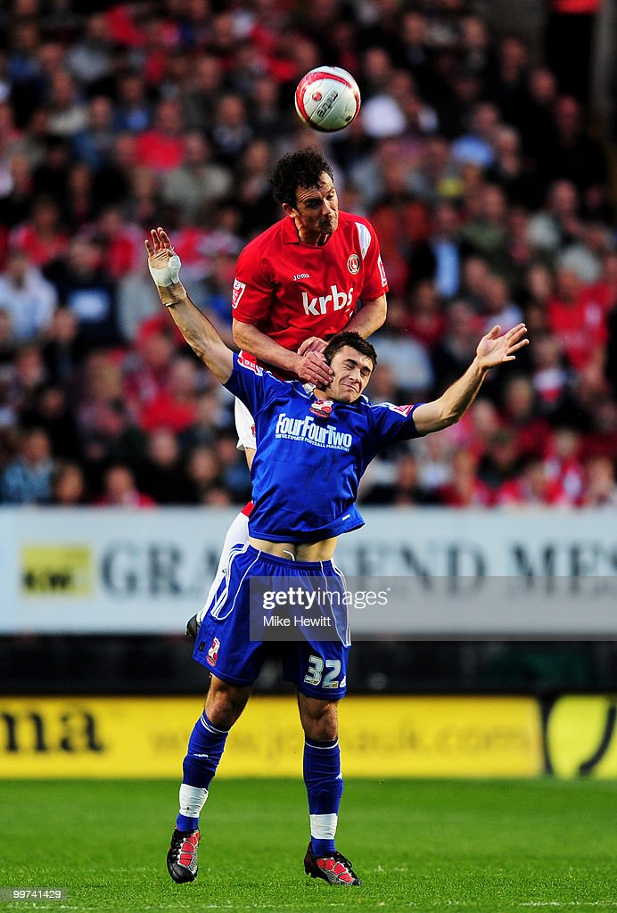Christian Dailly of Charlton rises above Charlie Austin of Swindon during the Coca-Cola League One Playoff Semi Final 2nd Leg between Charlton Athletic and Swindon Town at The Valley on May 17, 2010 in London, England.