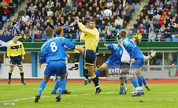 Christian Dailly of Scotland heads in the opening goal during the Euro 2004 Quallifying tie between Iceland and Scotland at the Laugardalsvollur...