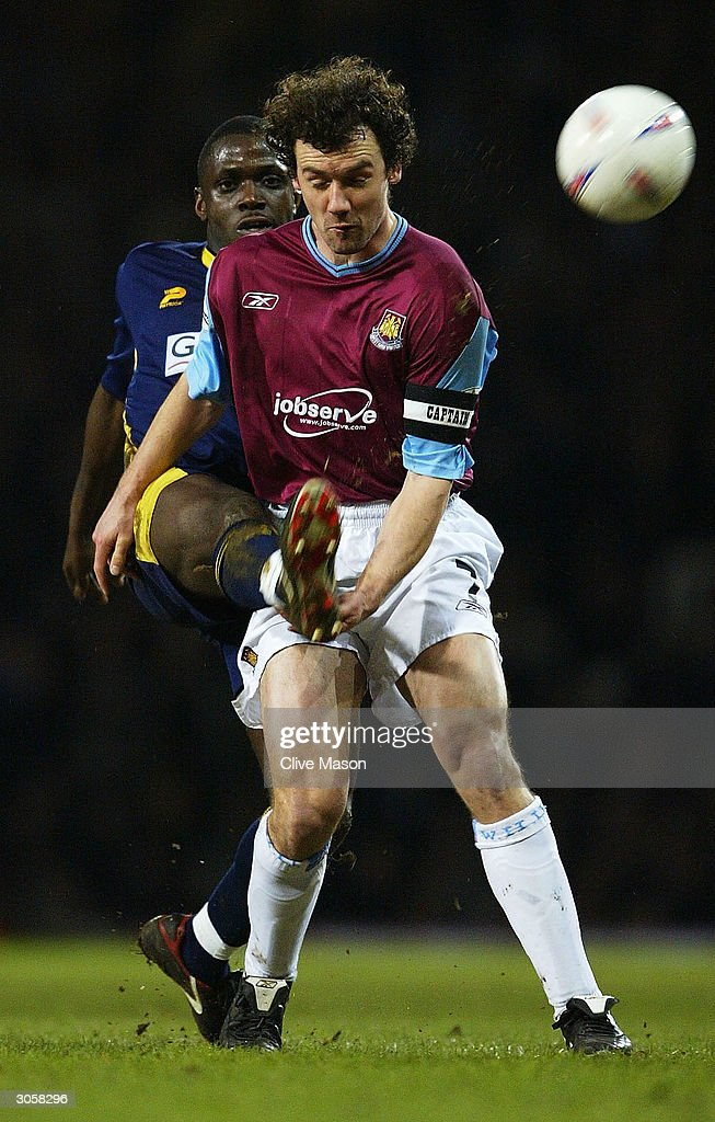 Christian Dailly of West Ham is challenged by Wayne Gray of Wimbledon during the Nationwide Division One match between West Ham United and Wimbledon at Upton Park on March 9, 2004 in London.